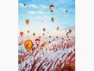 Воздушные шары над зимними горами