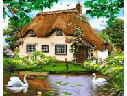 Домик у пруда с лебедями